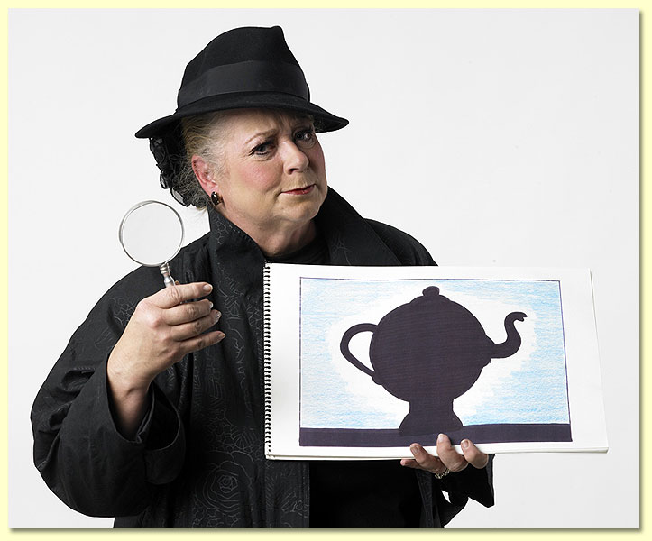 Photo of Imma Sleuth, a Texas Library Association edutainer in a black trenchcoat, with magnifying glass.