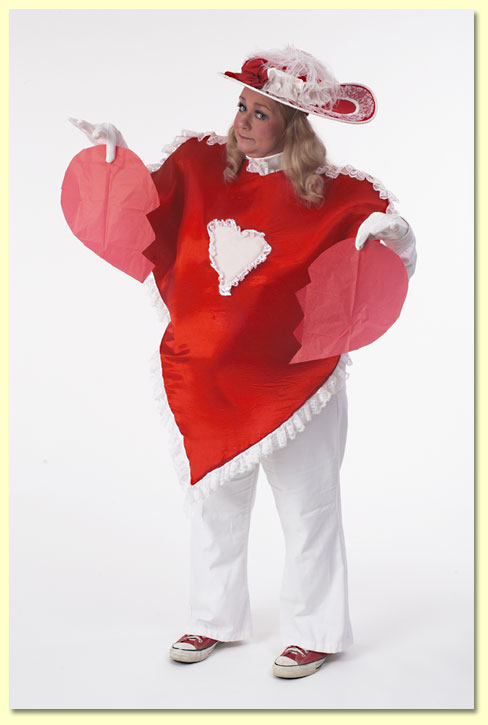 Photo of Margaret Clauder's character Lovey Dovey holding a torn paper heart.
