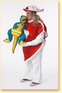 Photo of Lovey Dovey with Grouchy the dragon puppet.