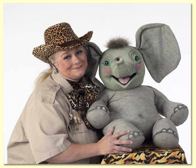 Picture of Margaret Clauder as Masai Maggie with Sneezy the elephant puppet.
