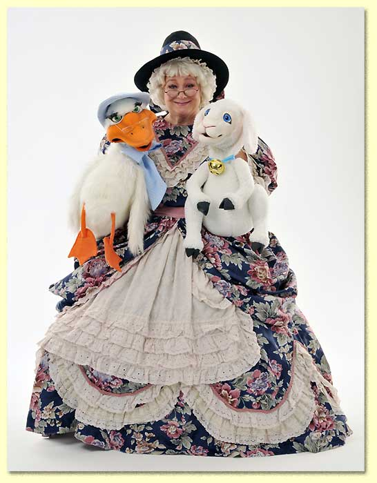 Photograph of Mother Goose; played by Margaret Clauder; with her Axtel puppets Goosey and Lamby.