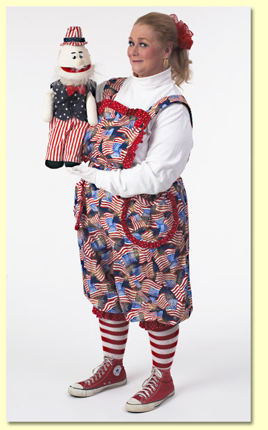 Picture of Margaret Clauder dressed as Patriotic Patty with the Uncle Sam puppet.
