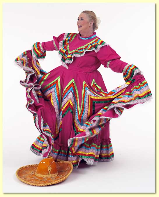Large photograph of Margret Clowder in a Mexican dress draped in ribbons.