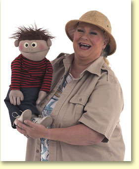 Picture of Margaret Clauder, puppeteer, with Elmer, a hand puppet.