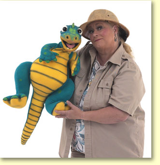 Photograph of Margaret Clauder dressed as Paleo Maggie, with a read-a-saurus puppet.